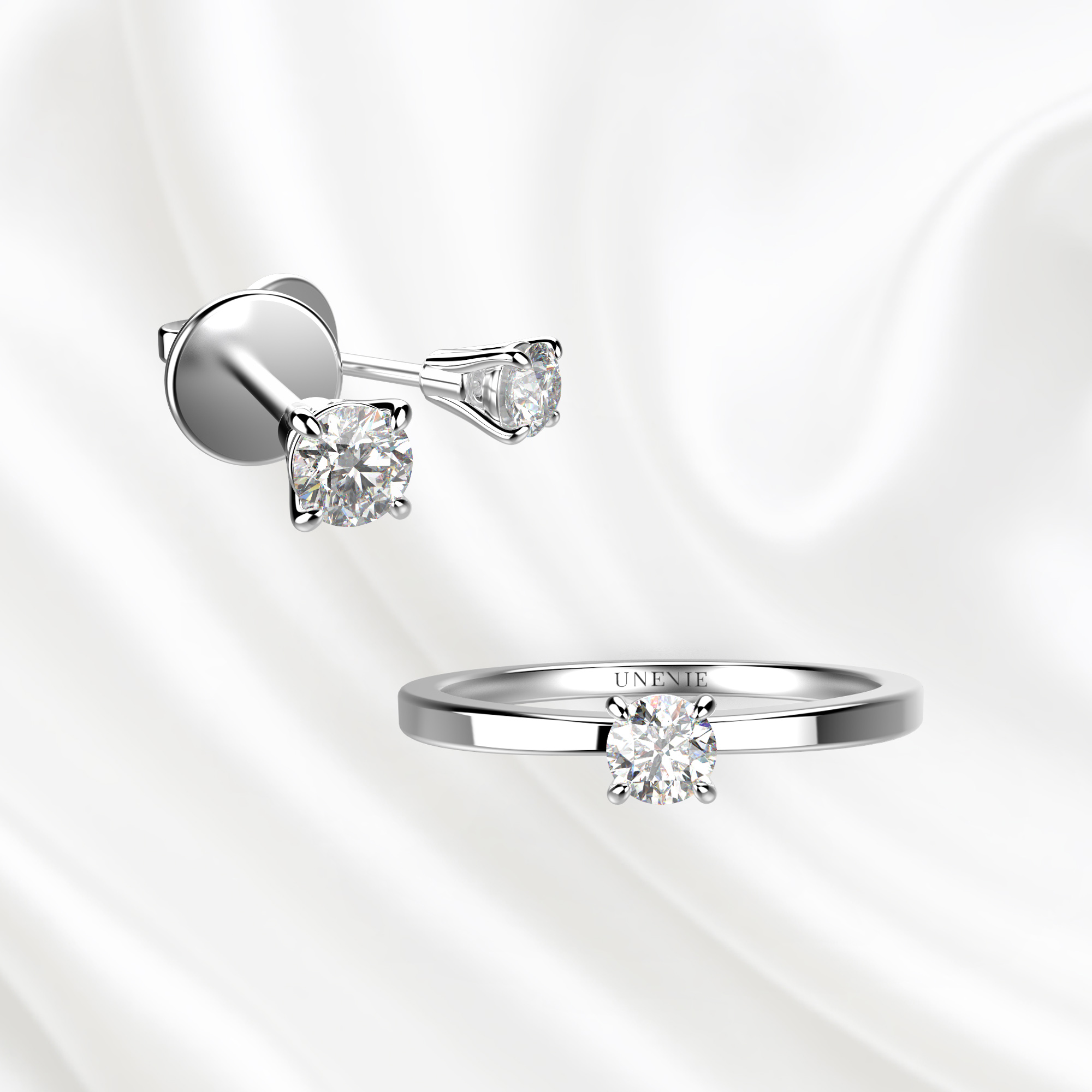 К1 комплект ювелирных изделий серьги и кольцо из белого золота с бриллиантами 0.1 карат