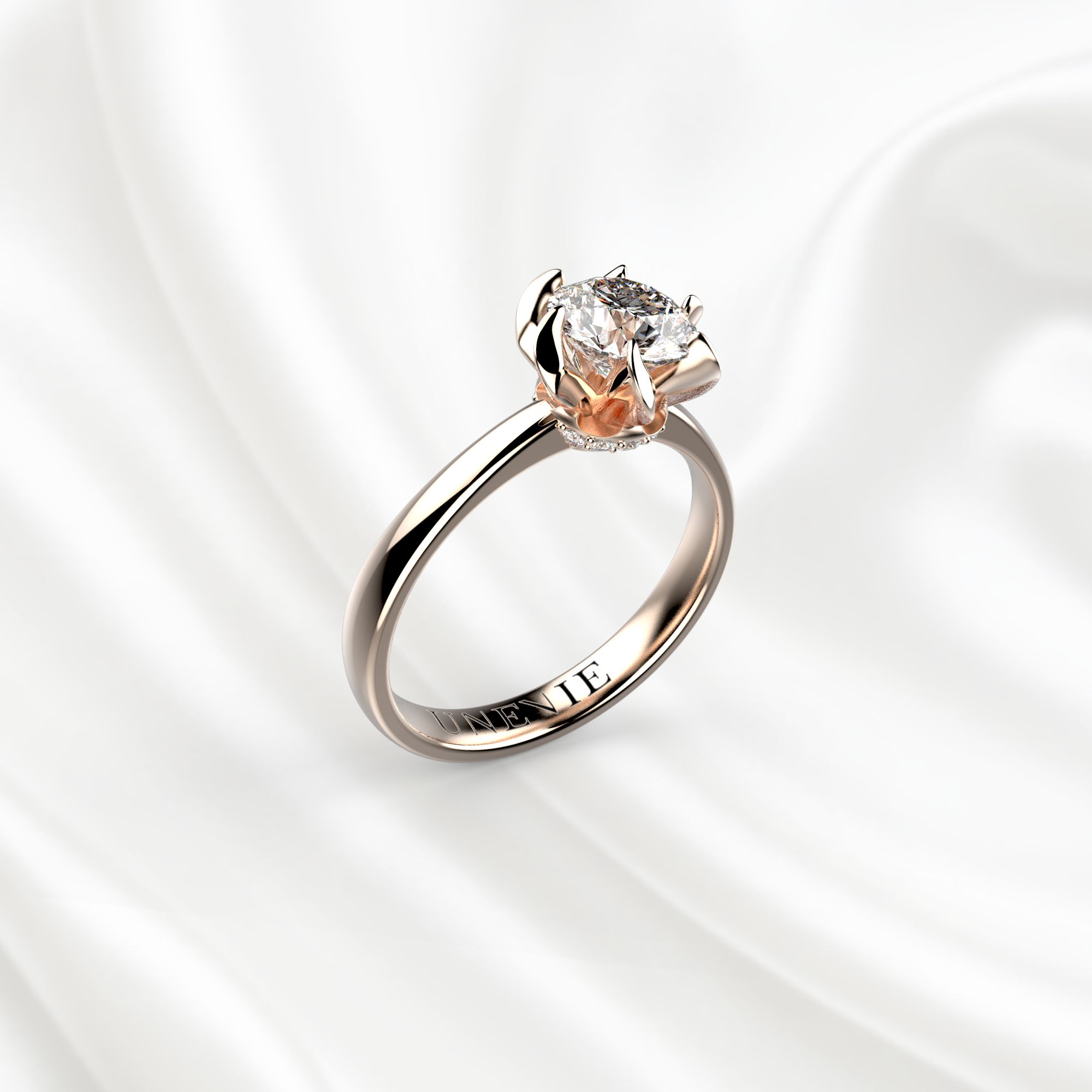 N11 Помолвочное кольцо из розового золота с бриллиантом 0.7 карат