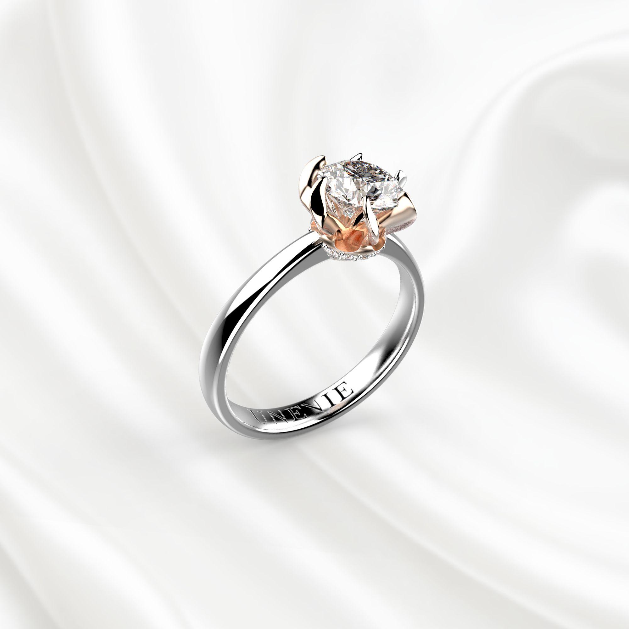 N11 Помолвочное кольцо из бело-розового золота с бриллиантом 0.7 карат