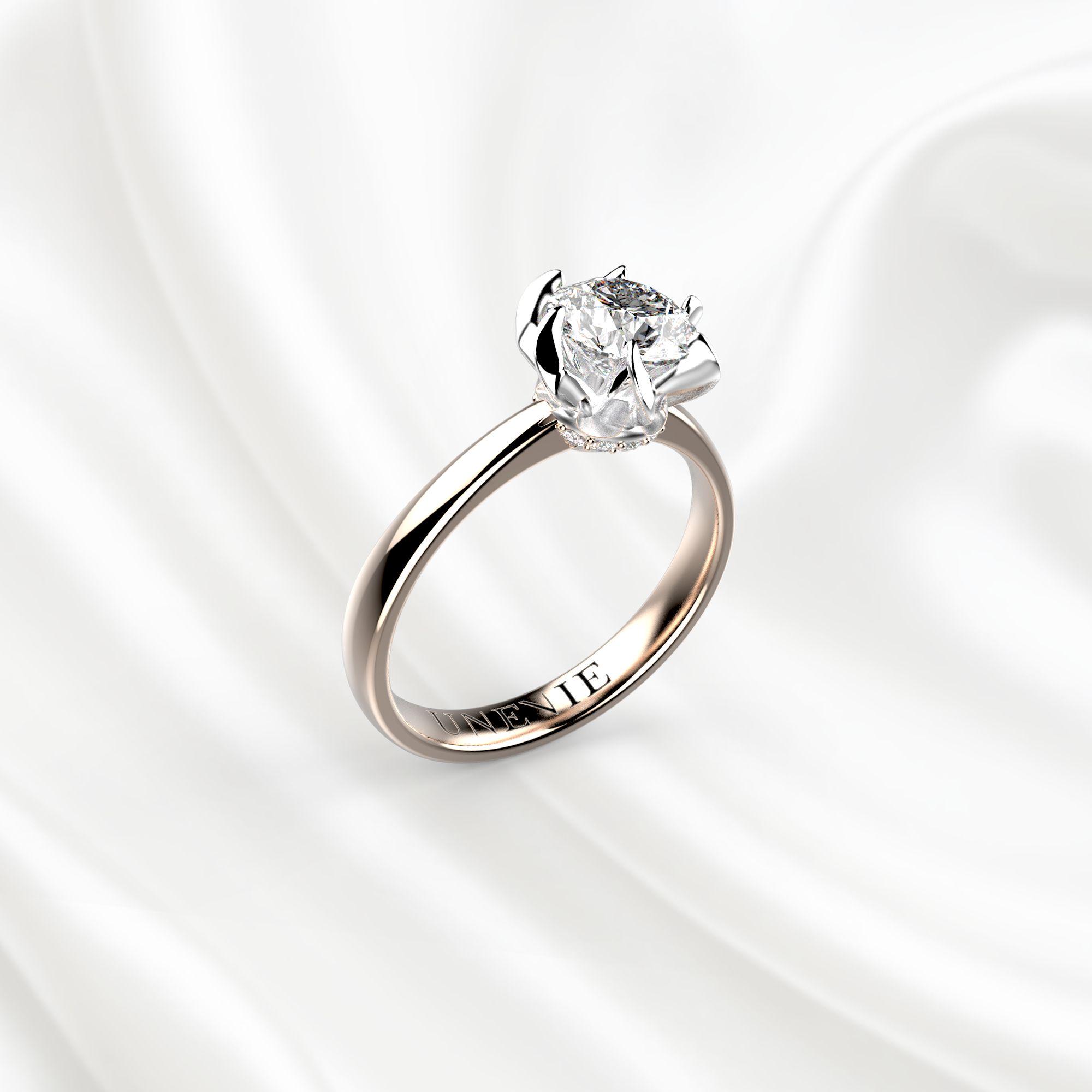 N11 Помолвочное кольцо из розово-белого золота с бриллиантом 0.7 карат