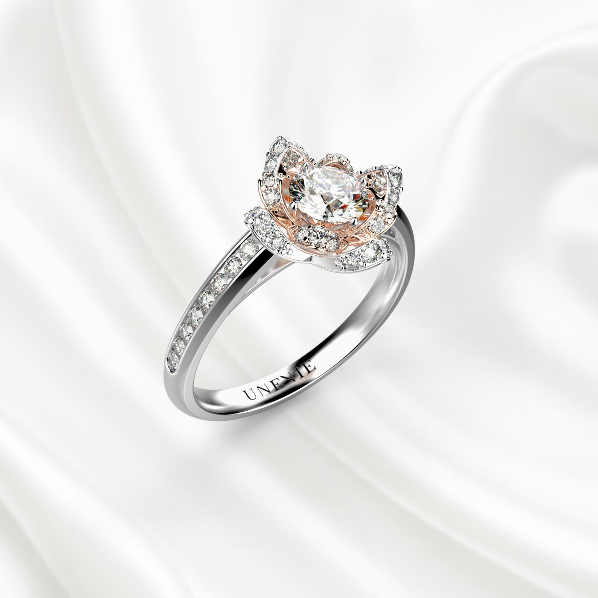 N13 Помолвочное кольцо из бело-розового золота с бриллиантом 0.35 карат