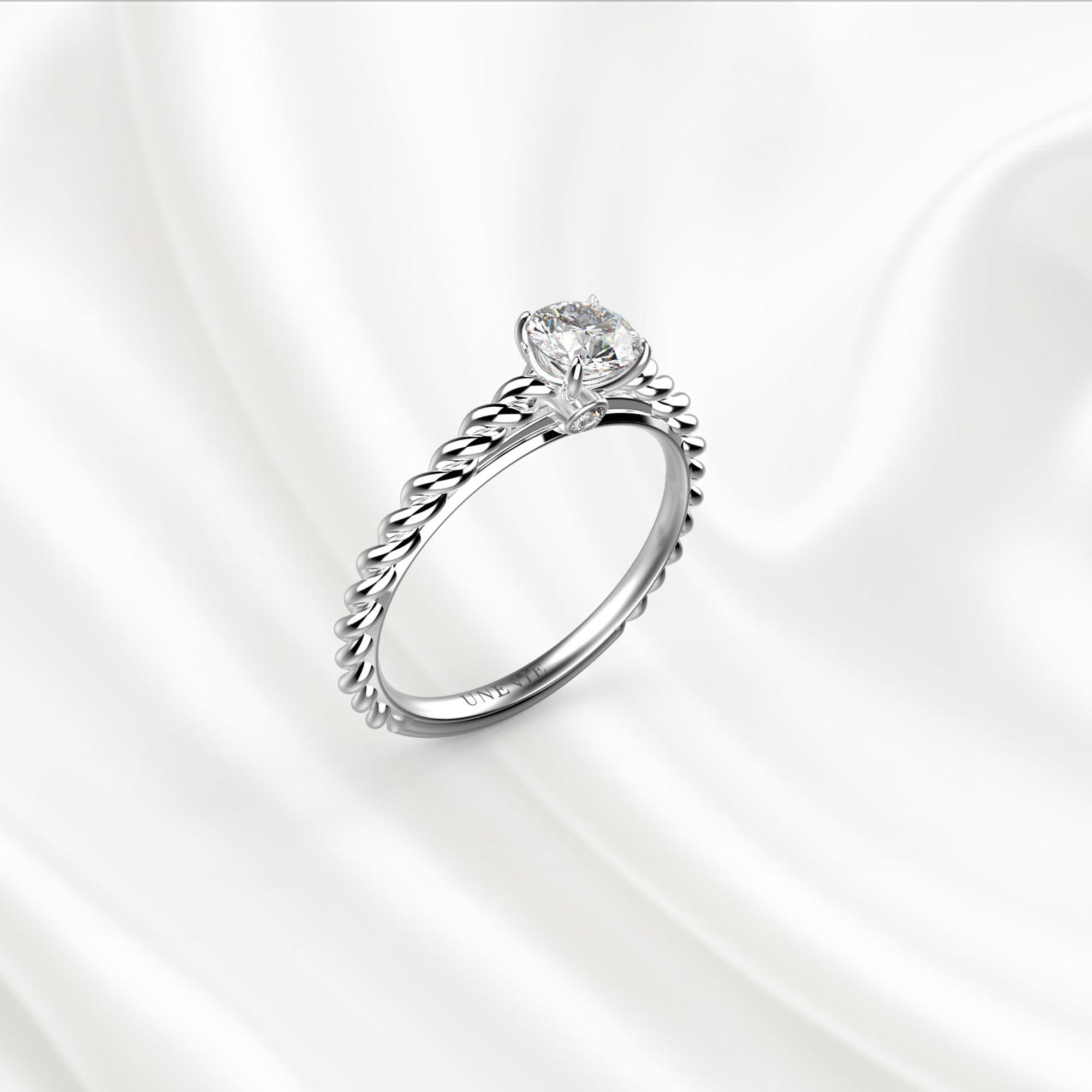 N14-1 Помолвочное кольцо из белого золота с бриллиантом 0.35 карат