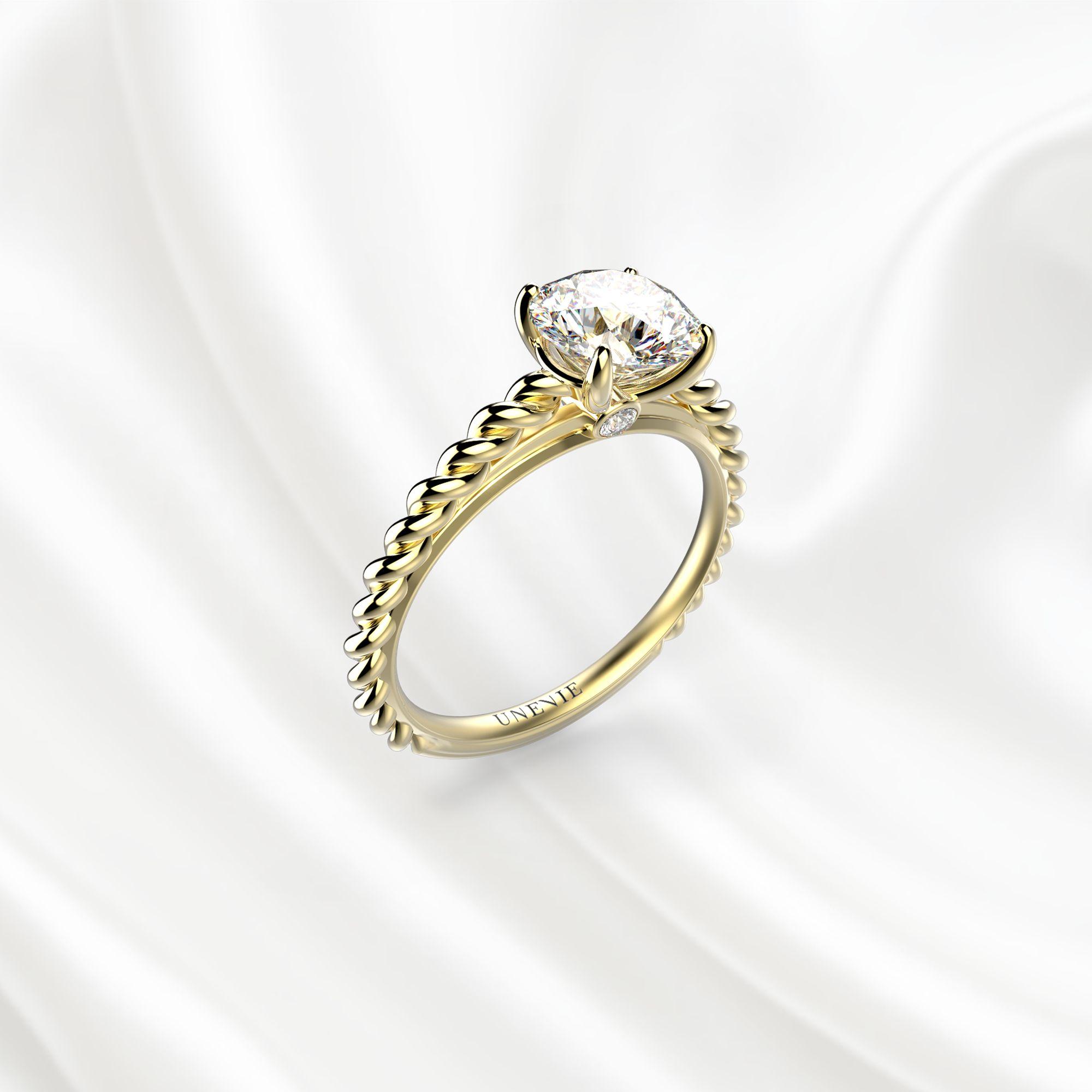 N14 Помолвочное кольцо из желтого золота с бриллиантом 0.6 карат