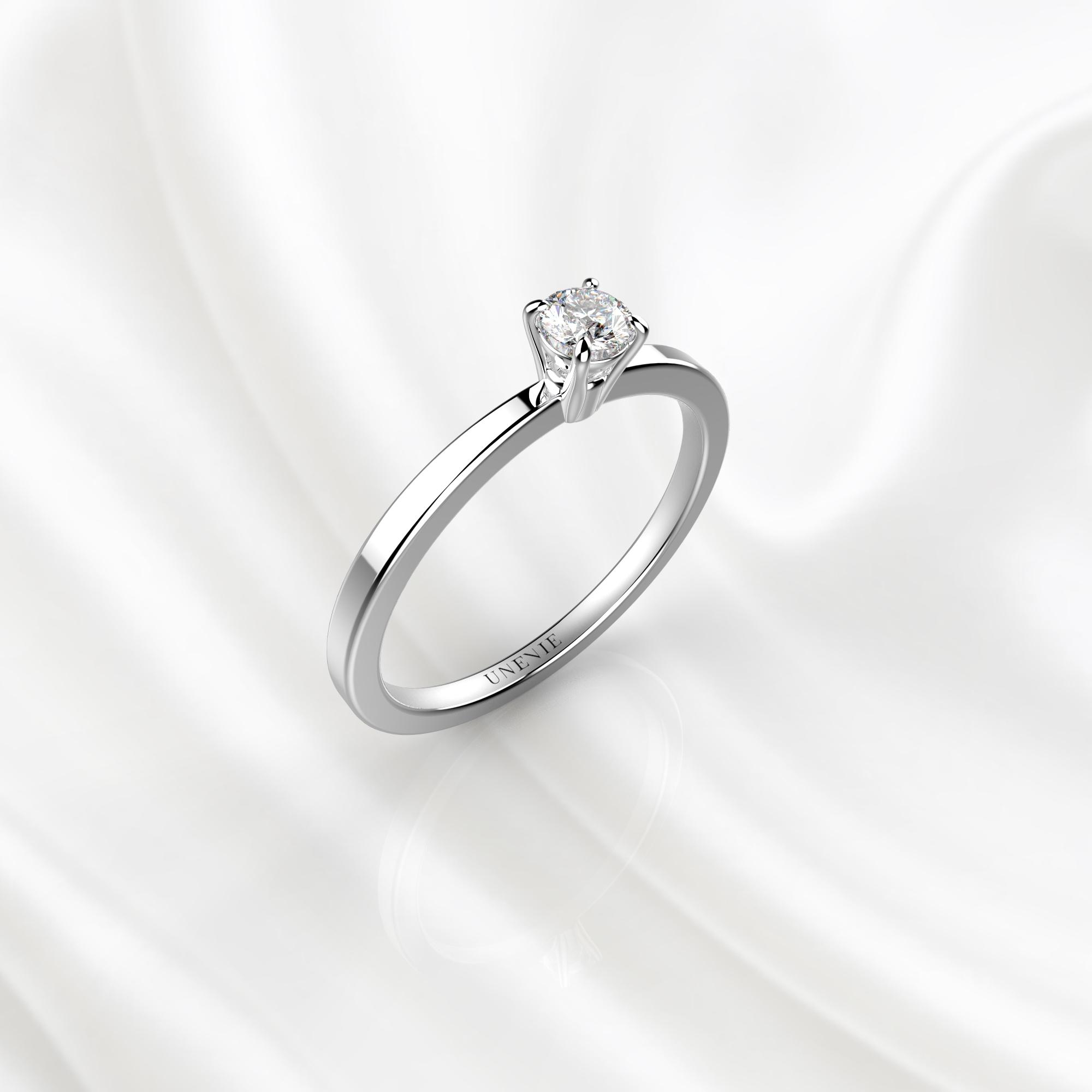 N22 Помолвочное кольцо из белого золота с бриллиантом 0.1 карат