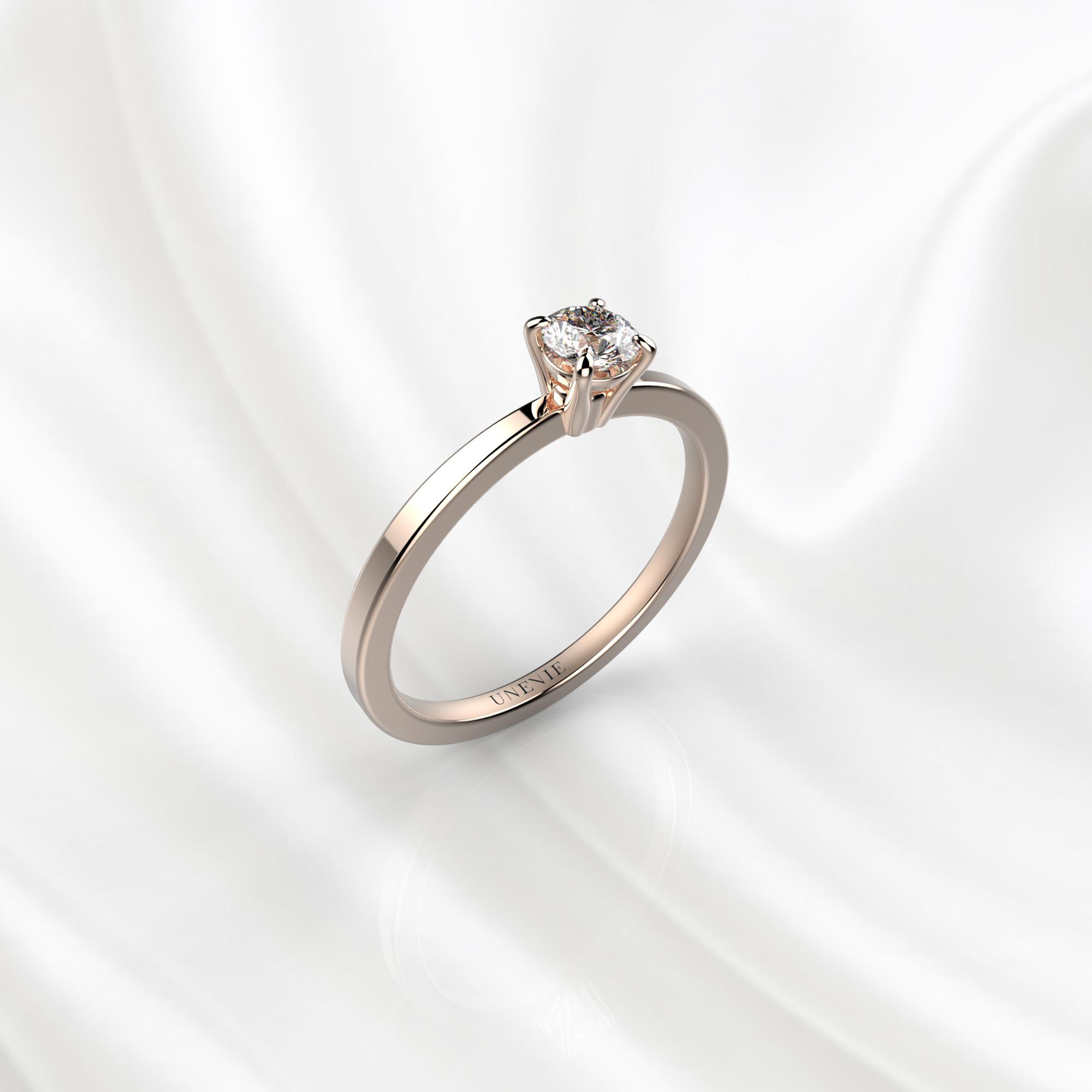 N22 Помолвочное кольцо из розового золота с бриллиантом 0.16 карат