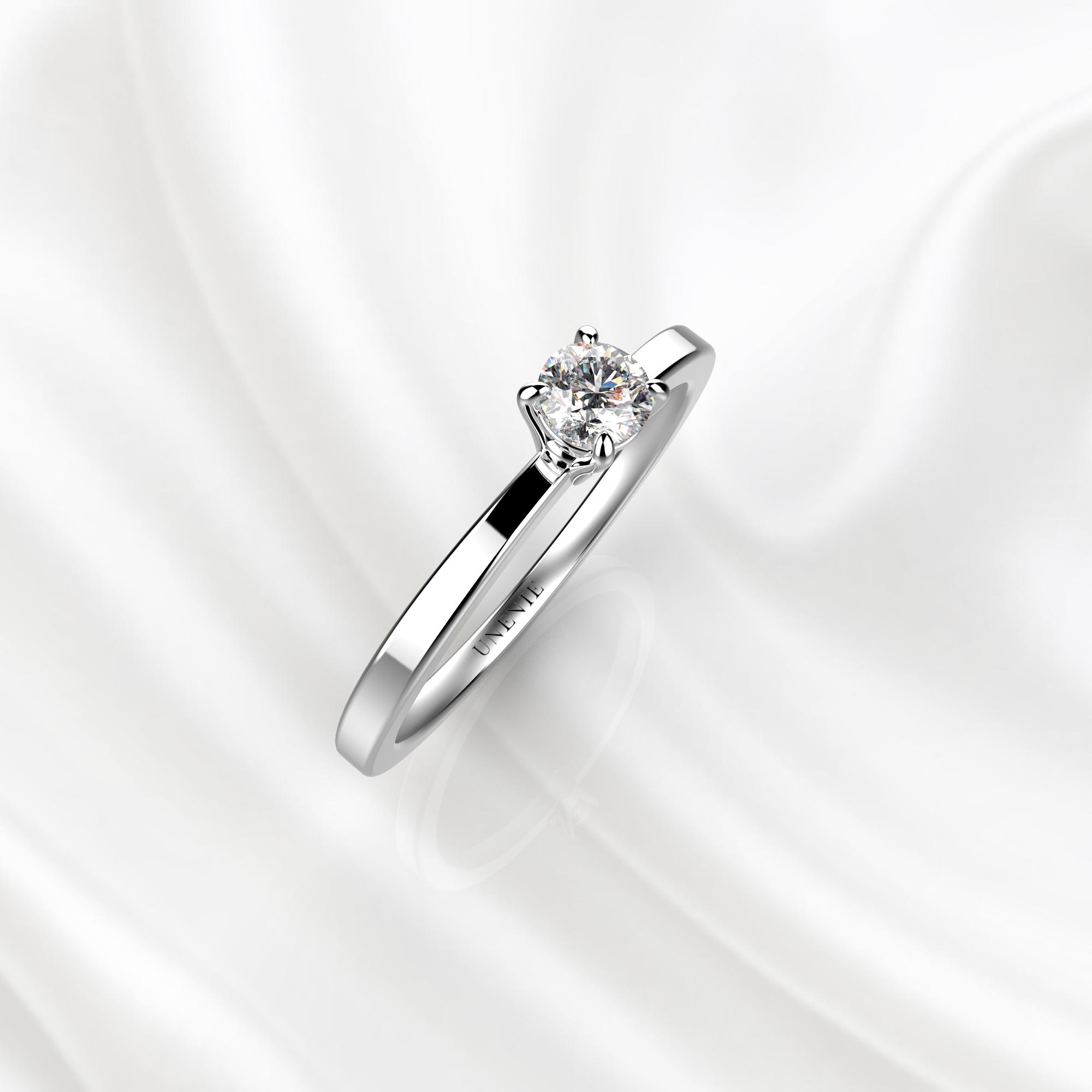 N22 Помолвочное кольцо из белого золота с бриллиантом 0.24 карат