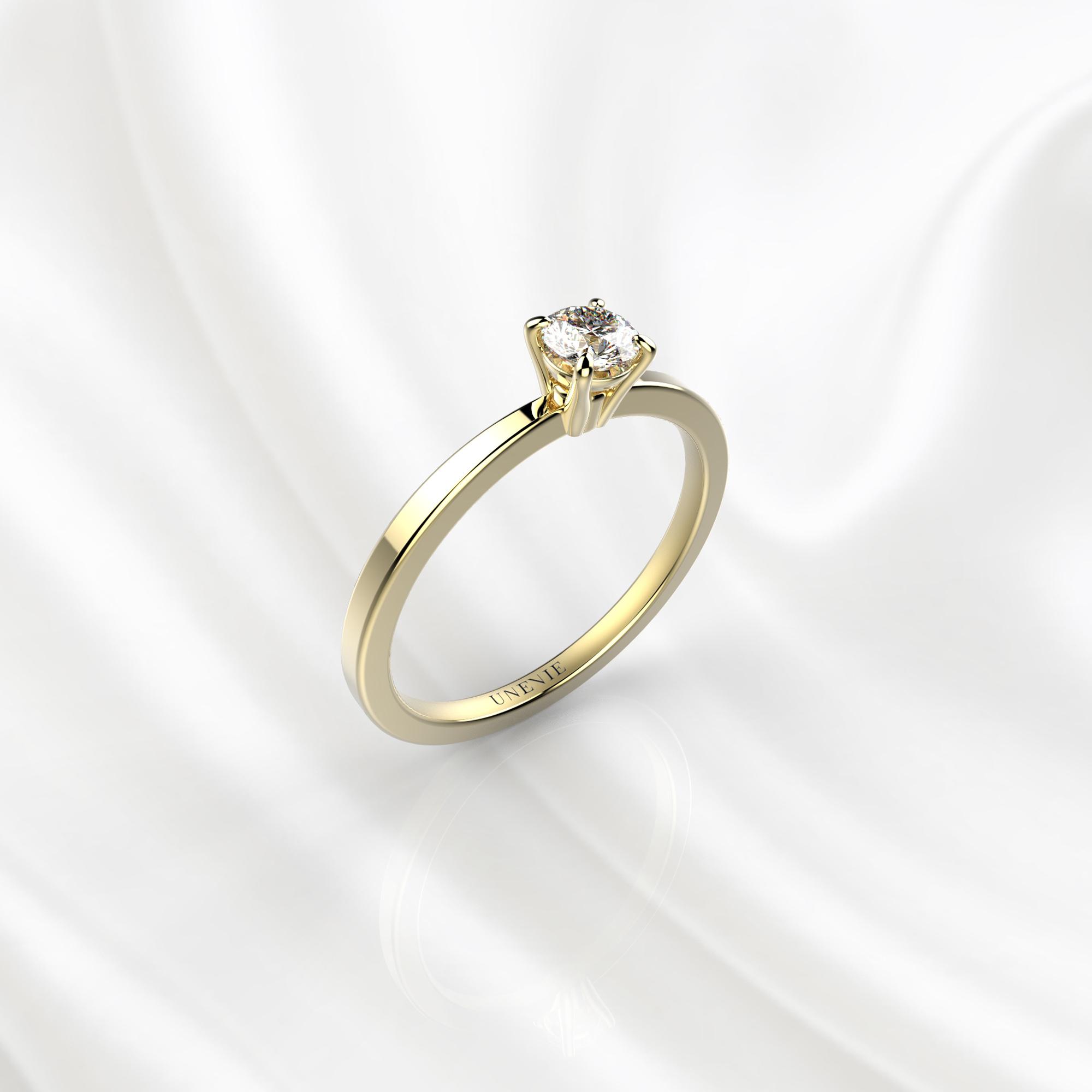 N22 Помолвочное кольцо из желтого золота с бриллиантом 0.16 карат