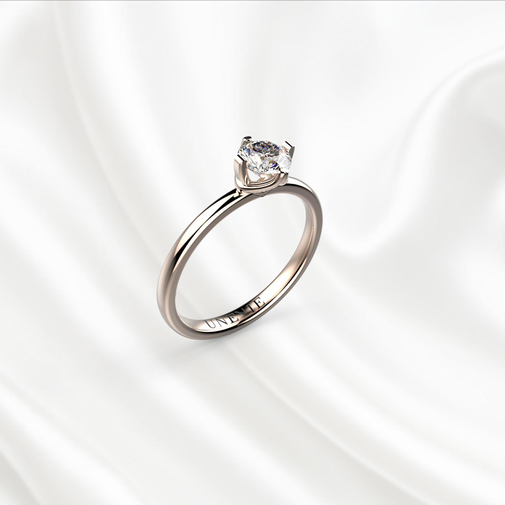 N12 Помолвочное кольцо из розового золота с бриллиантом 0.3 карат