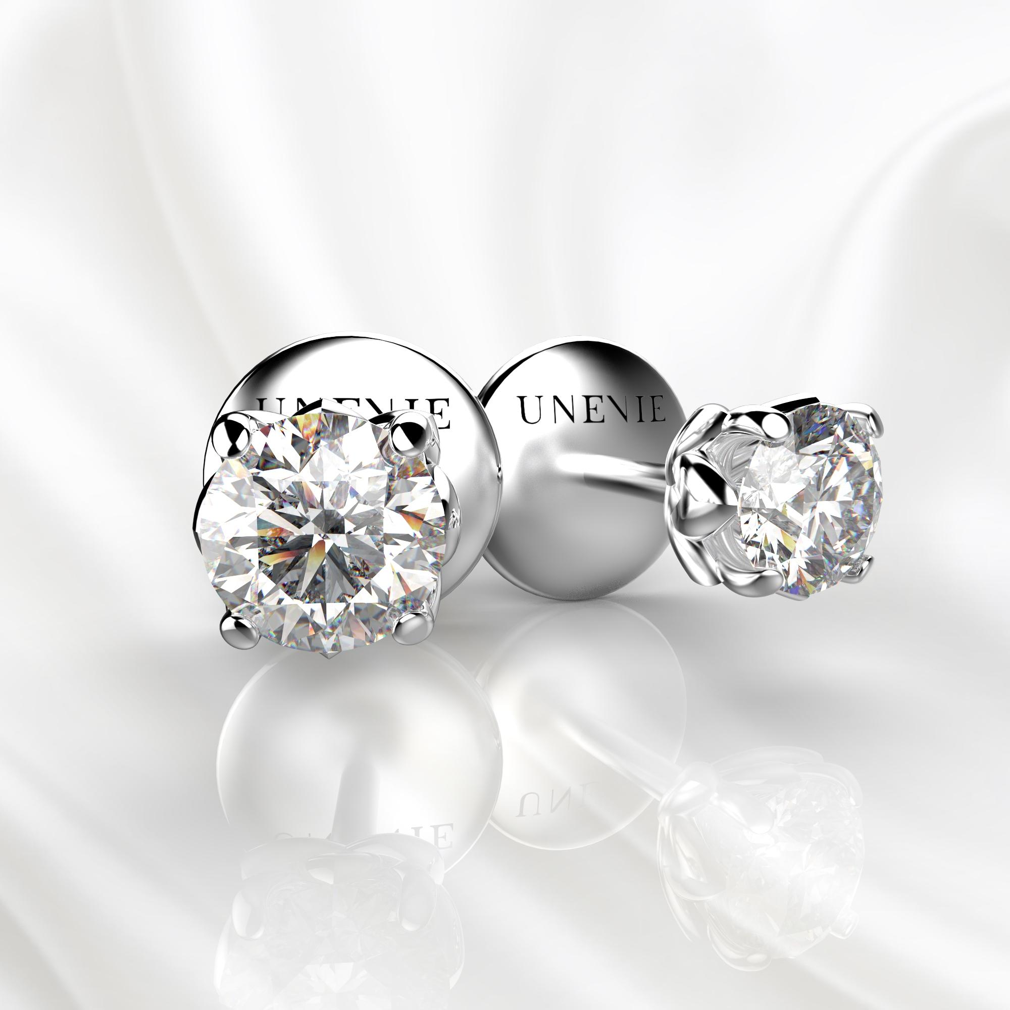 S15 Серьги-пусеты из белого золота с бриллиантами 0.2 карат